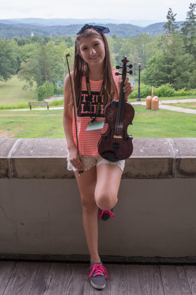 Fourteen-year-old Kiara Williams of Rock Cave, West Virginia has been playing fiddle for two years and recently won the youth fiddle championship at the Vandalia Gathering in Charleston.