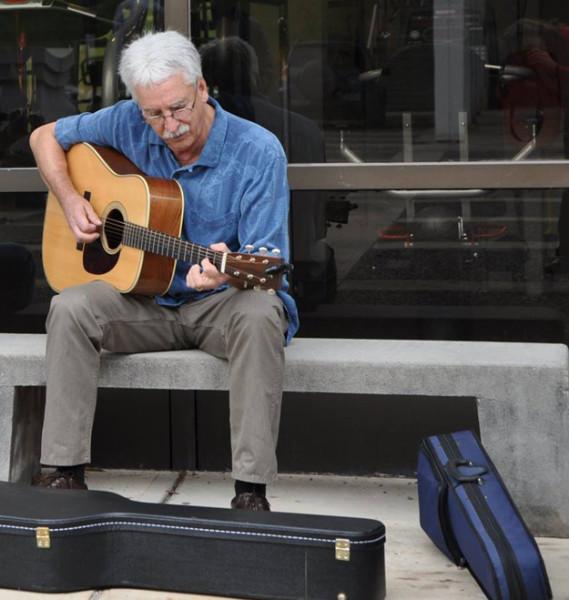 Gerry Milnes playing guitar.