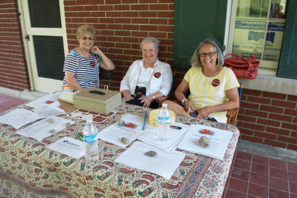 Volunteers at the Kump Center Fair on the Lawn greet folks with smiling faces. Photo by Andrew Carroll.