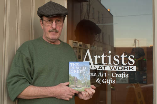 Author Joseph Lane outside of Artist at Work in downtown Elkins.