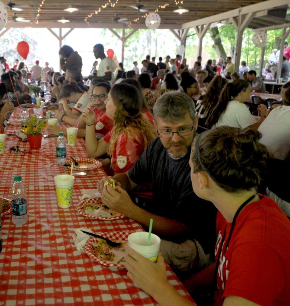 Photo Caption: Davis & Elkins College students enjoy a picnic with faculty and staff in the open-air Augusta Dance Pavilion.