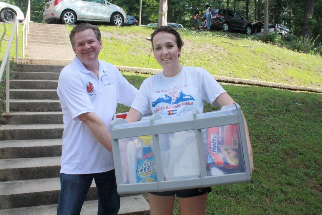 Photo Caption: Davis & Elkins College President Chris Wood helps student Lauren Gorsuch carry items to her residence hall. Gorsuch is a member of the women's lacrosse team.
